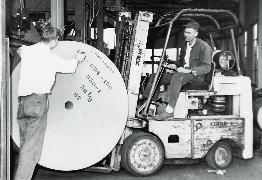 A forklift loads a roll of paper at the original Three Rivers location, circa 1950.